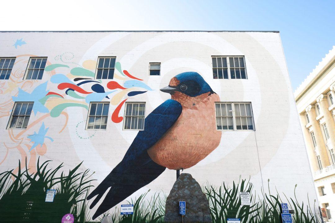 blue and tan bird mural