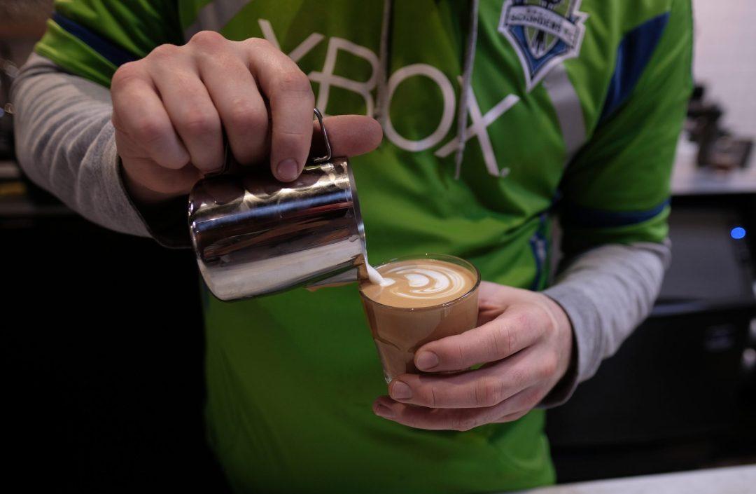 barista making latte art at Narrative Coffee