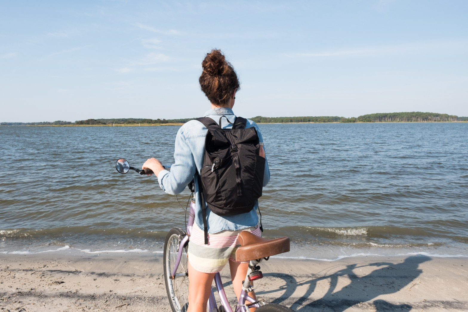 woman wearing the CamelBak Roll Top Backpack