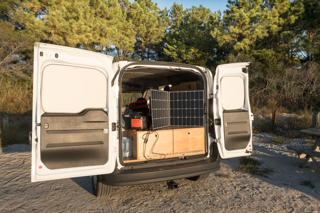 a photo of the backdoors open of a Ram Promaster City van using a Jackery Explorer 500 Portable Power Station and Solar Panel