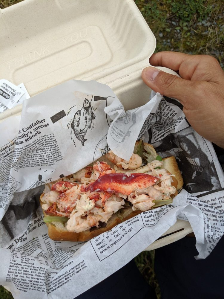 woman holding a lobster roll