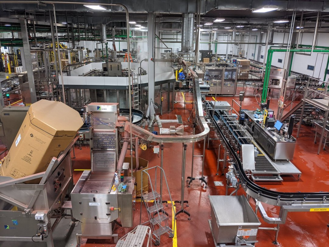 An overhead view during a brewery tour of the area where they bottle and package beer at New Belgium in Asheville.
