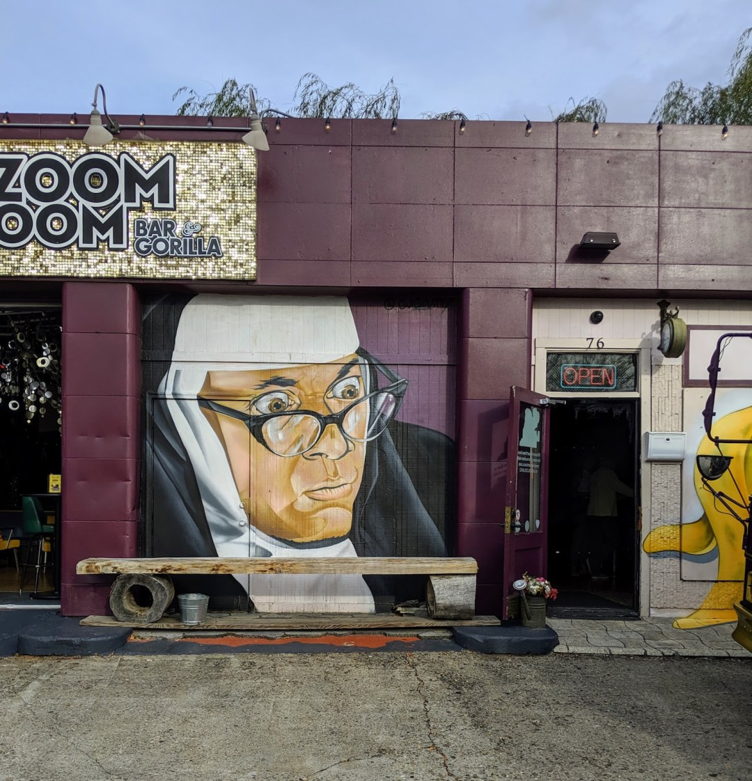 mural of a nun outside of the LaZoom Room