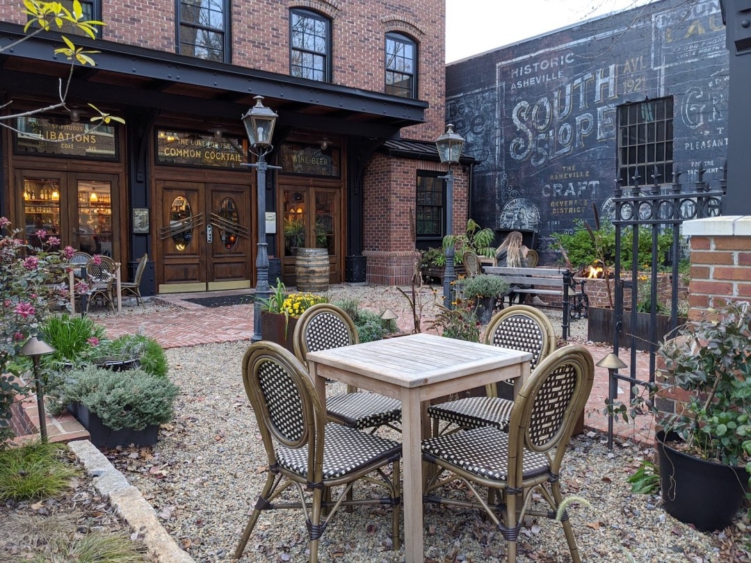 a photo of the outdoor patio of one of the best bars in Asheville, Chemist Spirits.