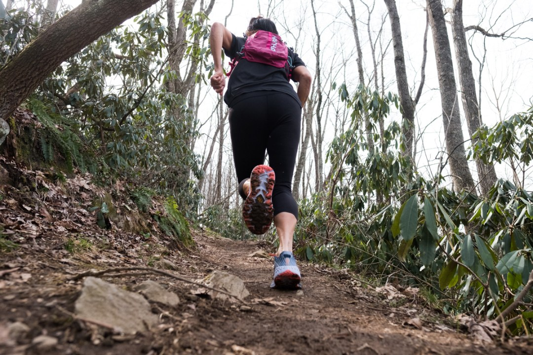 photo of a woman trail running in the Hoka One One Speeedgoat 4