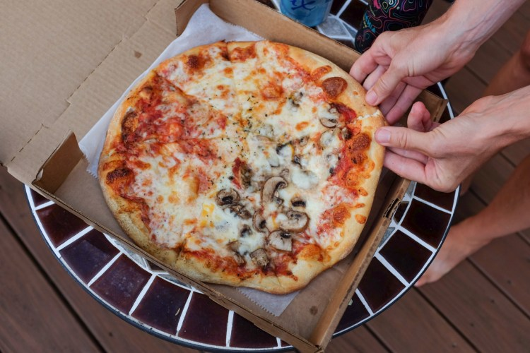 A half cheese, half mushroom pizza from Blue Mountain Pizza, one of the best places to eat in Weaverville, NC.