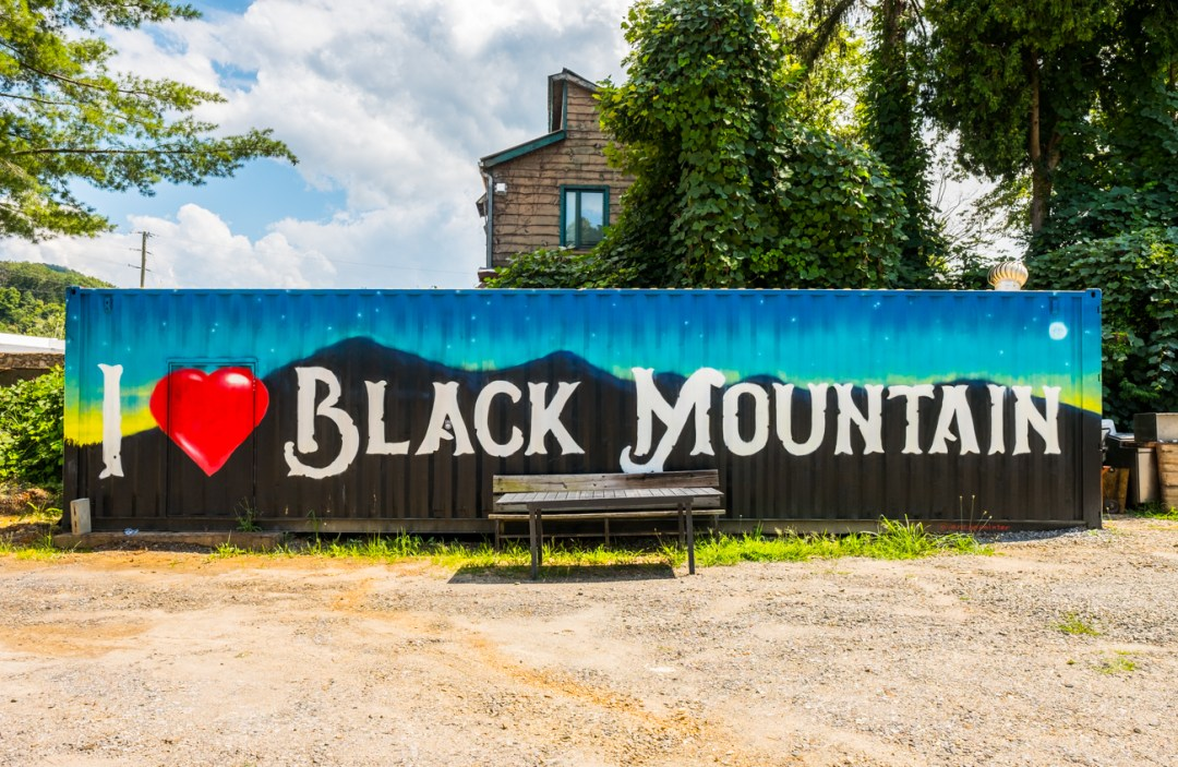 """a photo of a shipping container that has painted on it 'I Love Black Mountain"""""""