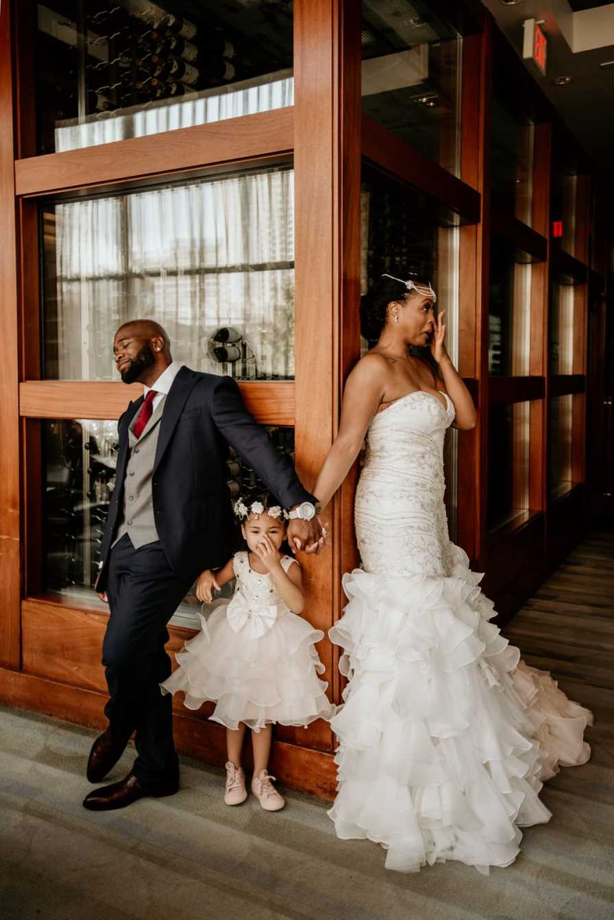 Bride, Groom and daughter with the Bride crying