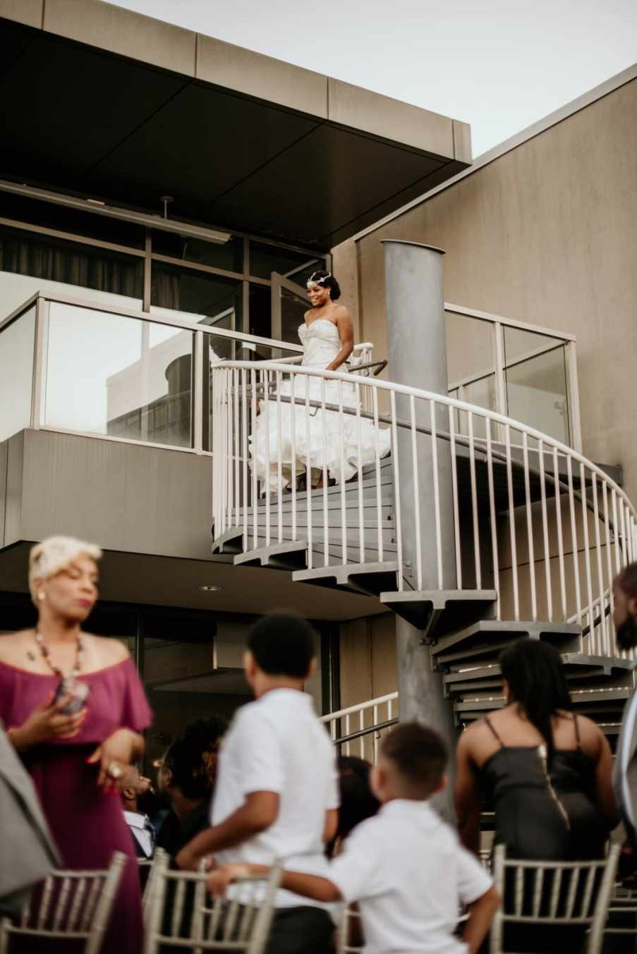 Bride descending the spiral staircase at Ventanas