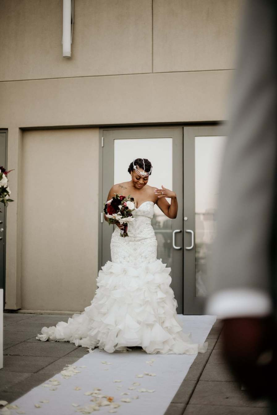 Bride overwhelmed with emotion walking down the aisle
