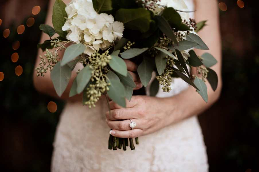 Wedding ring detail with bouquet