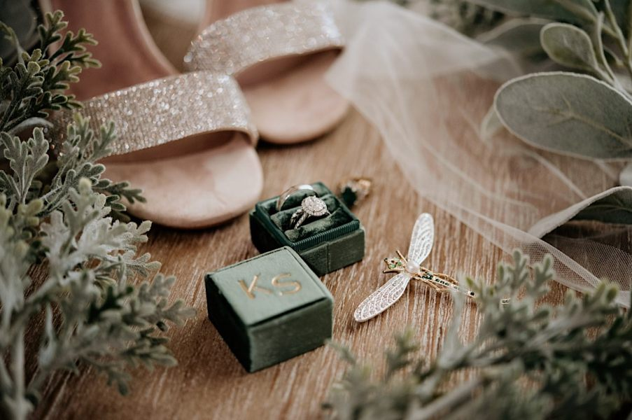 Wedding detail photography of engagement ring, wedding band and shoes