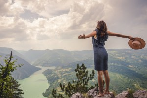 Photo of a woman on top of a mountain feeling free from her past after doing EMDR therapy in Castle Rock, CO. 80108 | 80109 | 80104