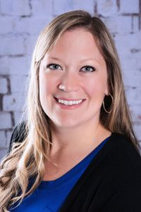A headshot of Ashley Brown at Authentic Connections. Working with a trauma therapist in Castle Rock, CO can help you in PTSD treatment. | 80109
