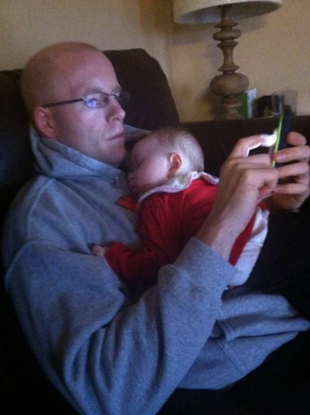 mobile blogging while cuddling with a baby