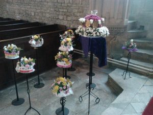 flower arrangement depicting the Lords declaring loyalty to the Queen