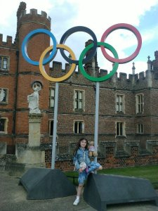 Laura in front of the Olympic rings at Hampton Court, after the cycling events