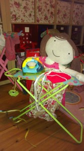 Photo of rag doll at toy ironing board