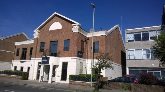 Photo of studio exterior against bright blue sky