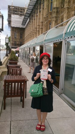 Debbie on the terrace of the House of Commons with an ALLi flyer