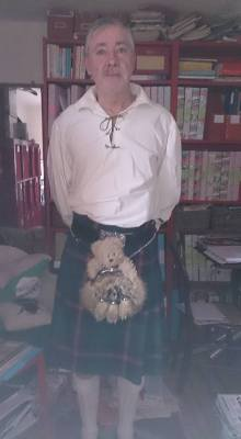 Photo of Gordon in Highland dress with a teddy bear in his sporran