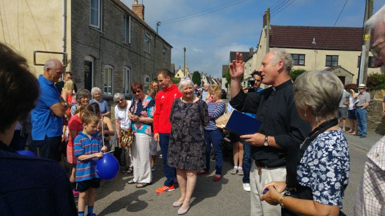 Photo of vicar doing a blessing in front of the crowds