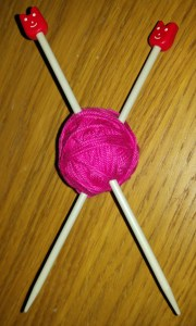 pink yarn and knitting needles