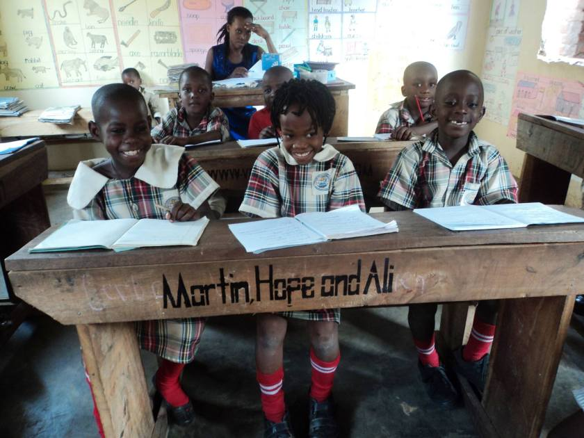 picture of children at desk with Martin, Hope and Ali painted on it