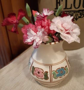 small pottery vase of pinks