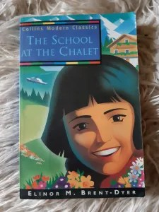 cover of a modern edition of The School at the Chalet