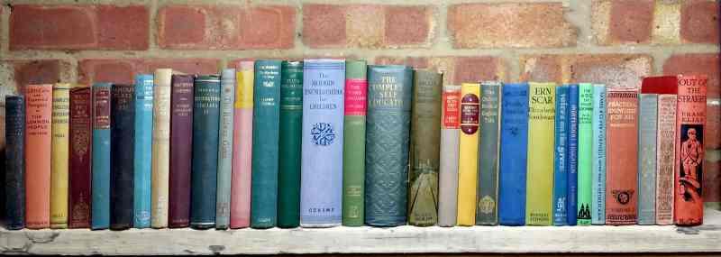 photo of a long shelf of vintage hardbacks