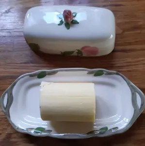 solid slab of butter on butter dish