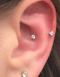 Snug piercing also different types of ear piercings  the complete list rh authoritytattoo