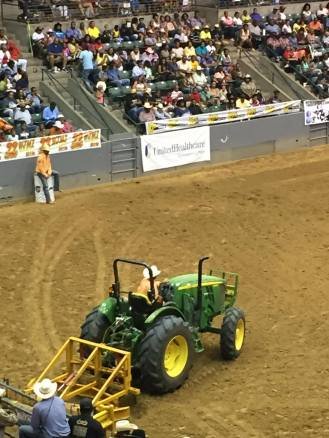 After bulldogging event, cowboys make a trail for barrel races. Photo Courtesy of Tamoria Harvey