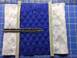 fold ends of quilted material