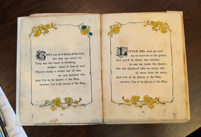 inside pages of book of alfred lord tennyson's poem the may queen
