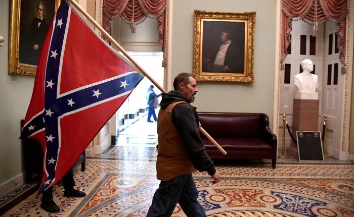 Trump supporter confederate flag in capitol