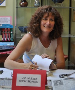 Author JP McLean busy signing copies of her books