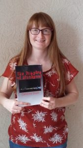 Author Catherine Green holding a copy of her new gothic novel The Vampire of Blackpool. Oh, to be beside the seaside!