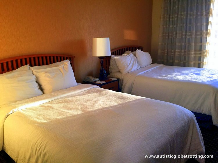 Family Stay at Embassy Suites Anaheim South Hotel beds