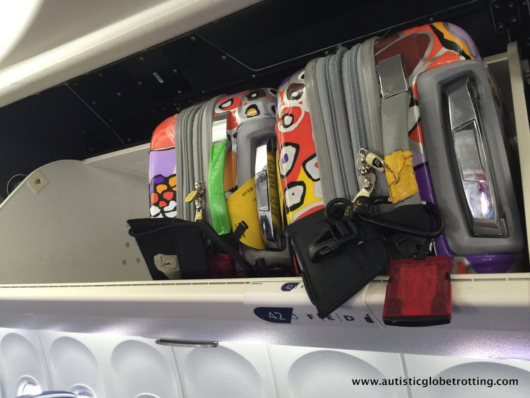 Airline Safety Tips to Practice with Kids suitcases in overhead bins on united