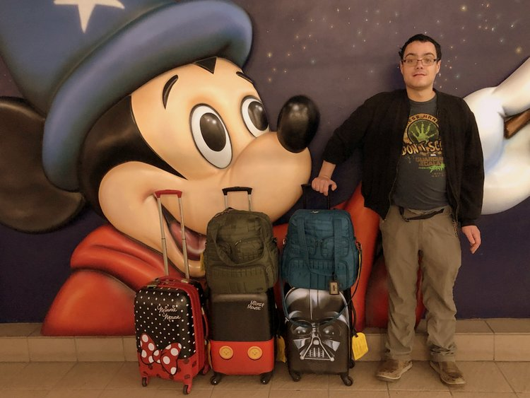 Is United MCO Red Carpet Lounge Family-Friendly suitcases near disney store mco