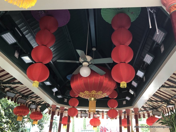 Attending Disneyland's Lunar Year Celebrations with Autism red fabric decorations