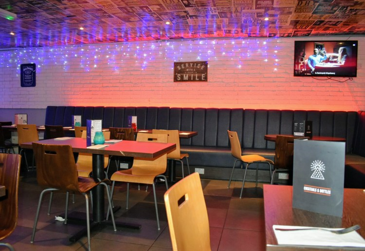 A restaurant with purple tinged lights