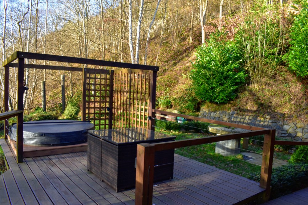 A hot tub and a table on wooden decking
