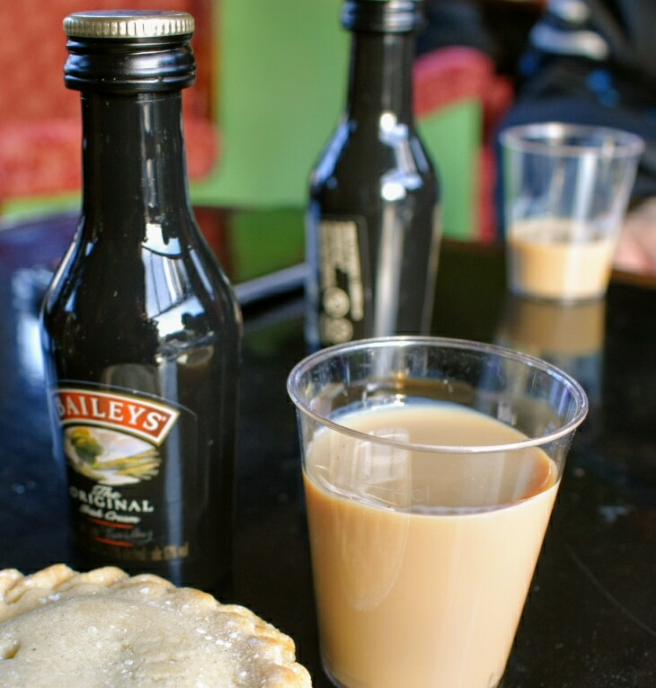 A bottle of Baileys and a cup of Baileys