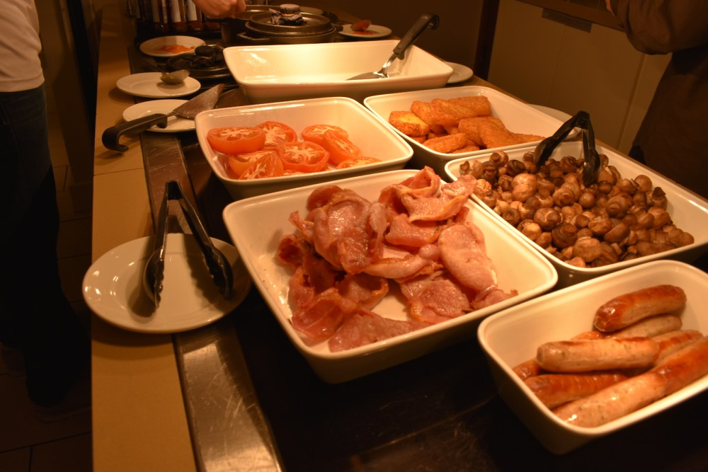 A selection of hot buffet breakfast items