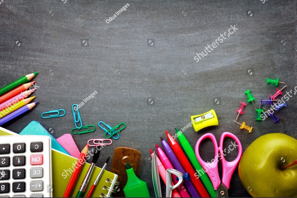Items on a school desk including pens and scissors