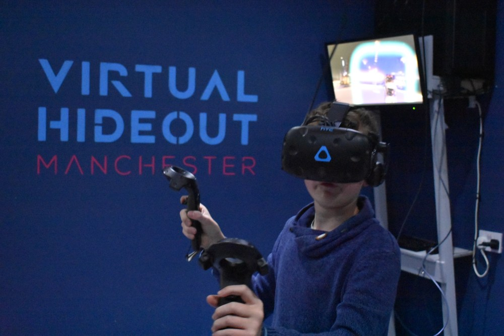 A boy in a VR headset at Virtual hideout manchester