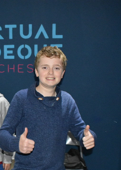 A boy giving the thumbs up at virtual hideout manchester